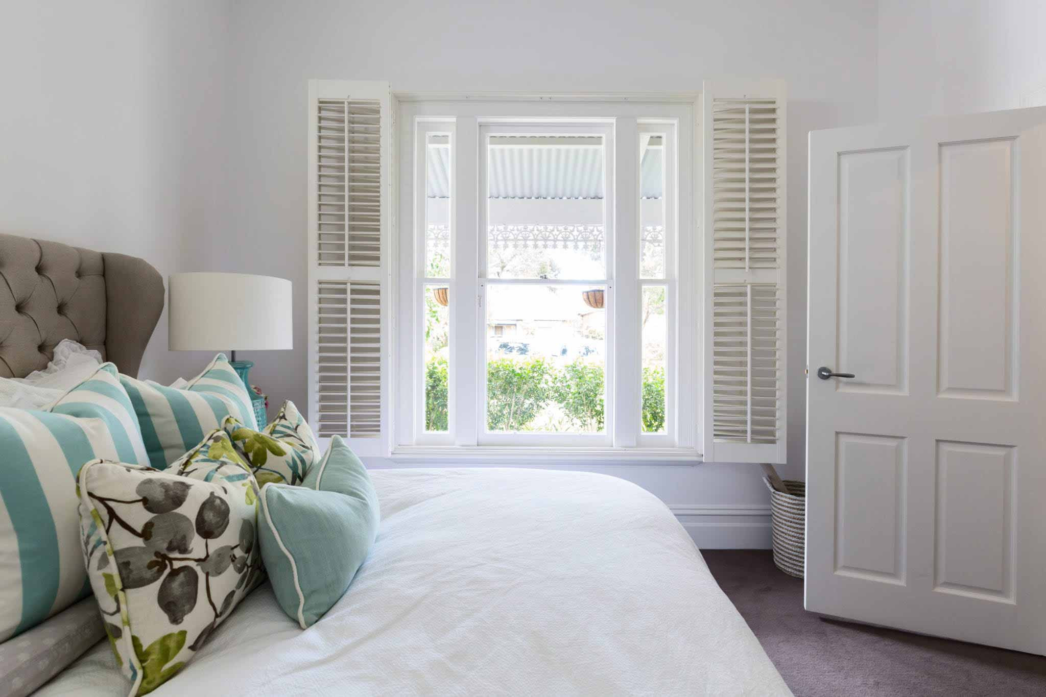 Internal shutters in bedroom.