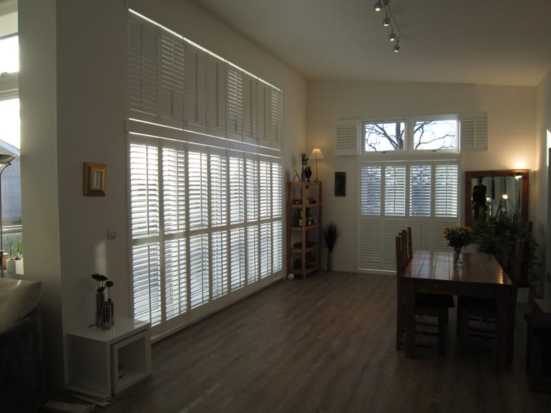 Indoor shutters partially closed