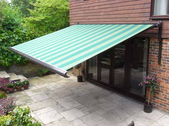 Green awning over doorway.
