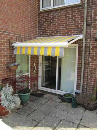 Small awning over doorway.