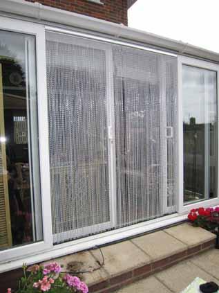 Flyscreen chain curtain on door.