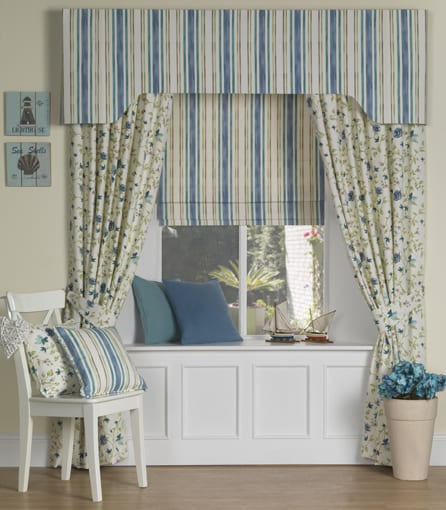 Curtains and matching roller blinds.