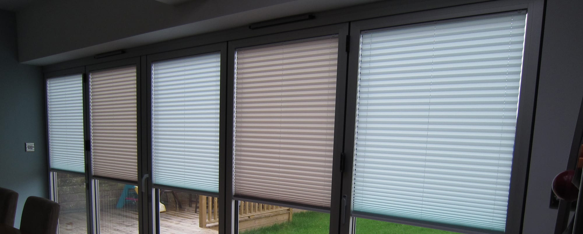 Bifold blinds pulled half way down.