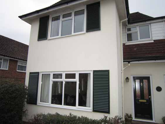External shutters on two story house.