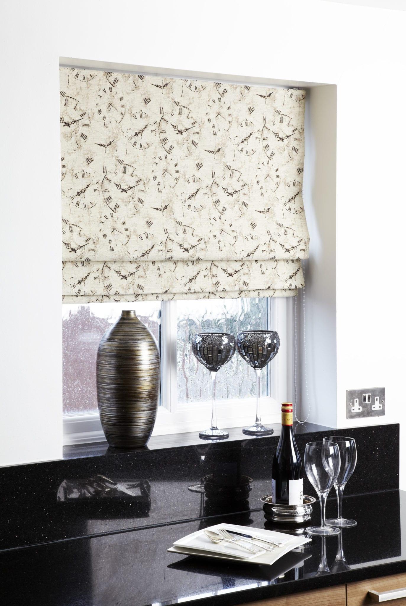 Clock pattern on roman blinds.