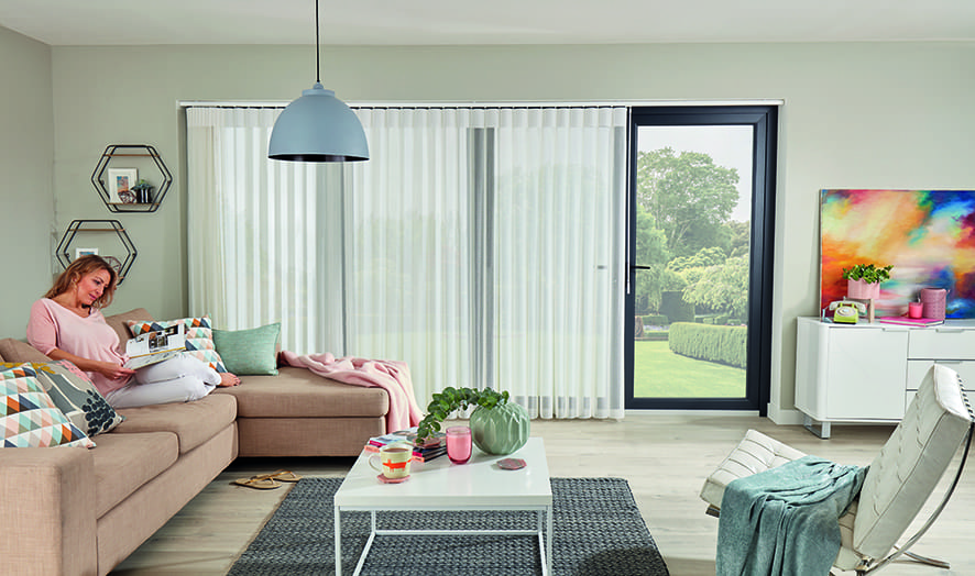 Free-hanging allusion curtains.