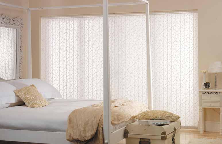 Vertical blinds in bedroom.