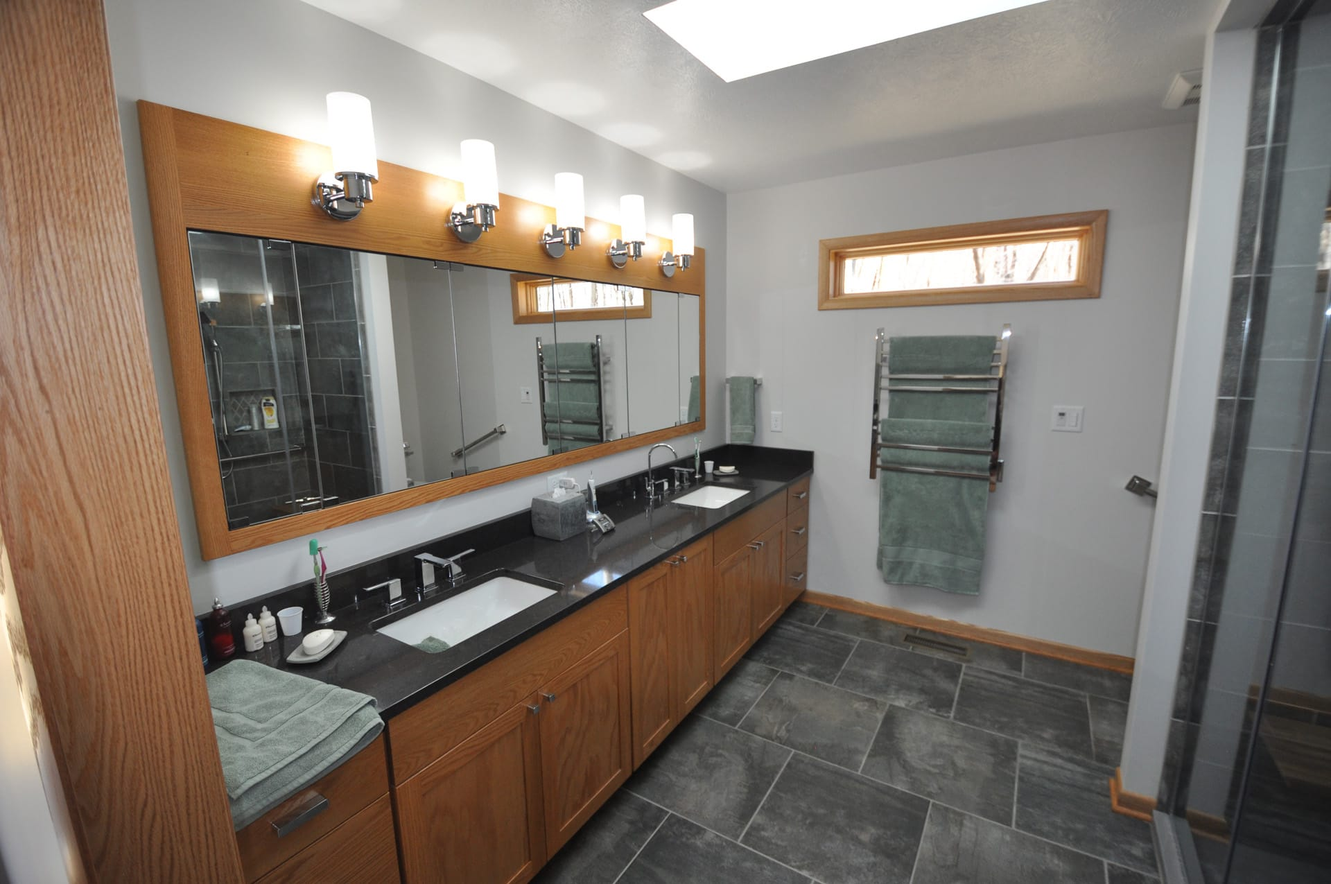 Large double vanity with heated wall-mounted towel warmer
