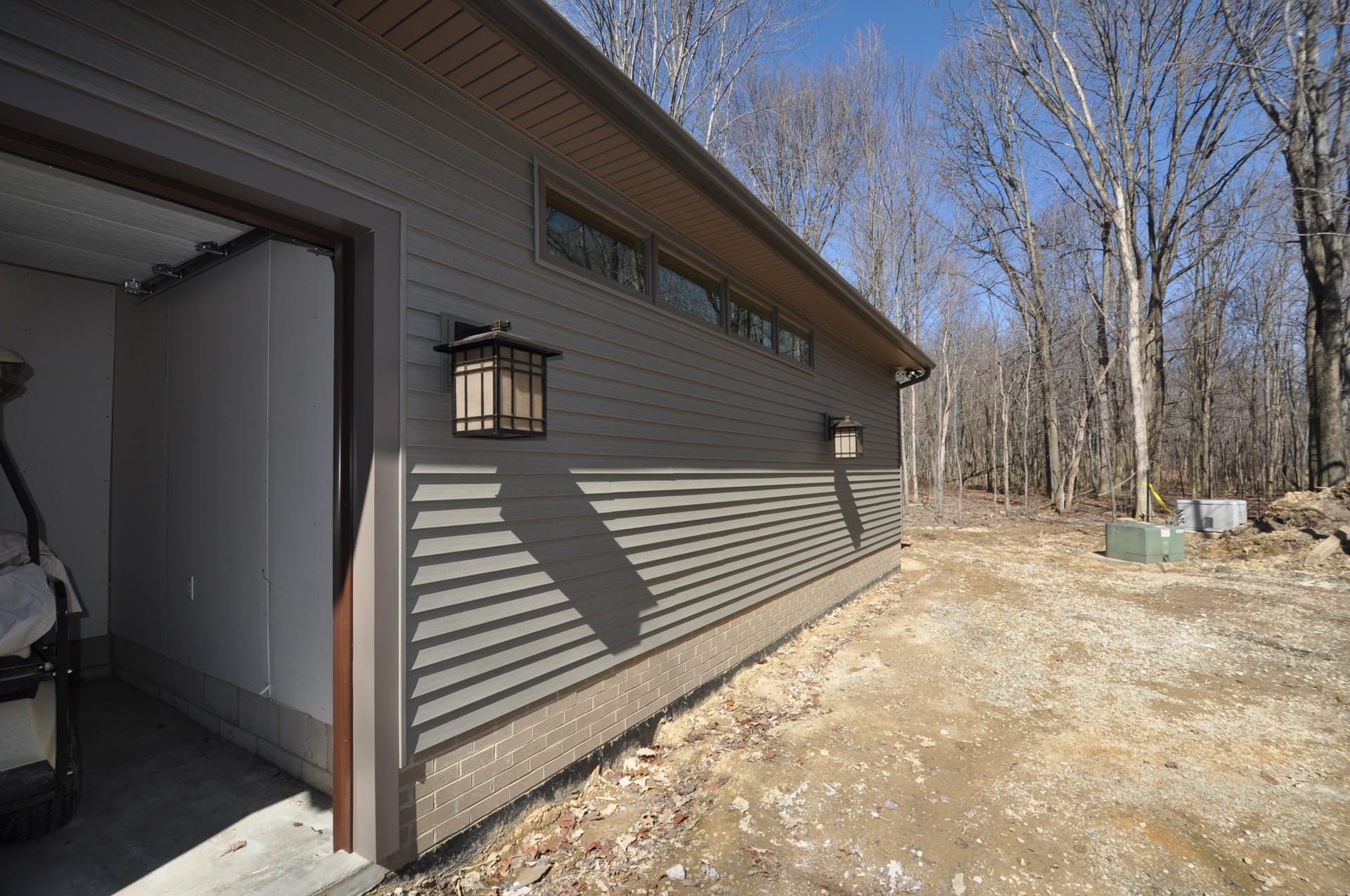 High windows to allow light in addition without compromising privacy/Golf cart garage