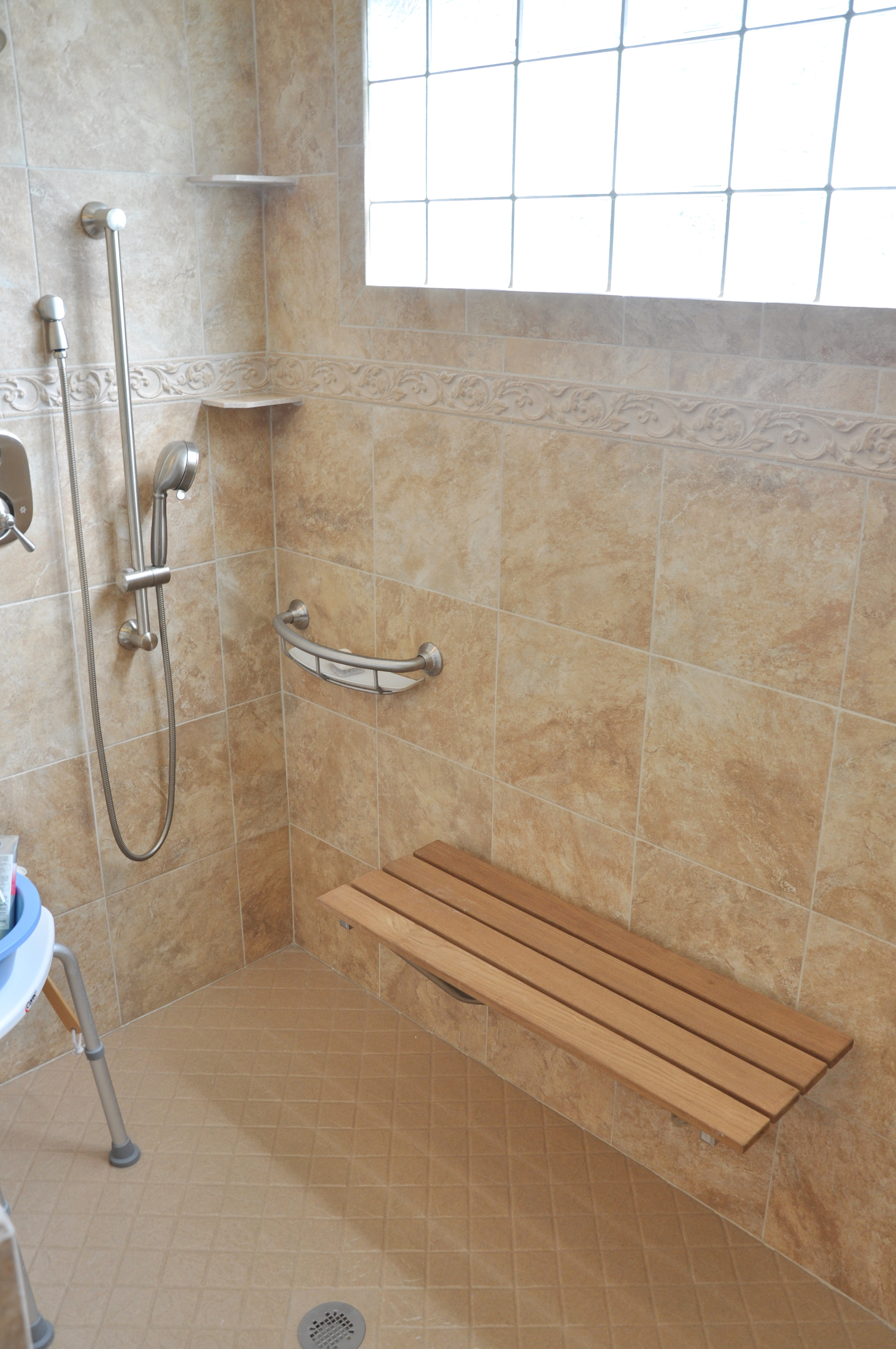 perfect walk-in shower for safety--bench, hand-held shower, soap dish grab bar