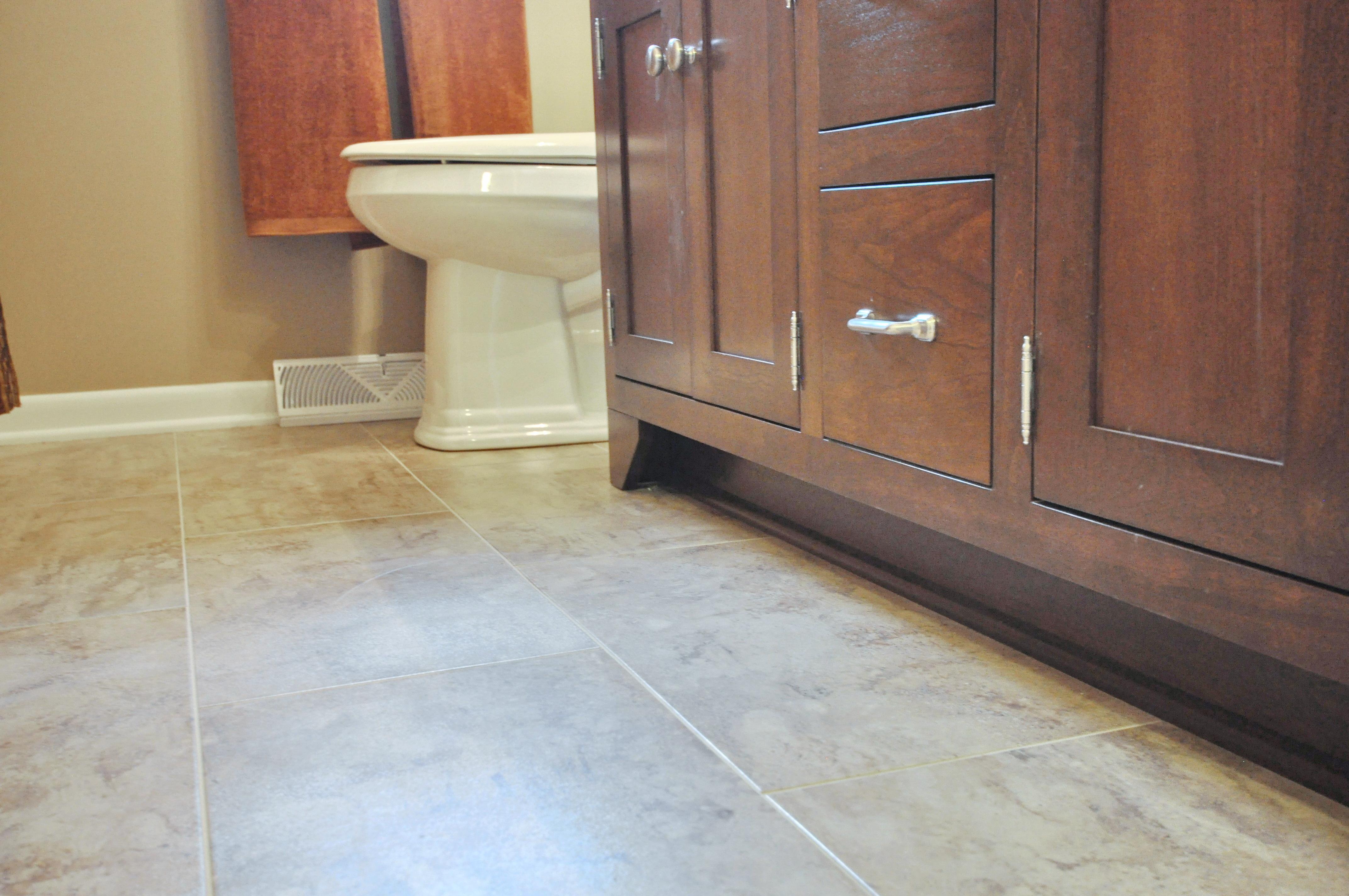 Grouted glue-down luxury vinyl tile