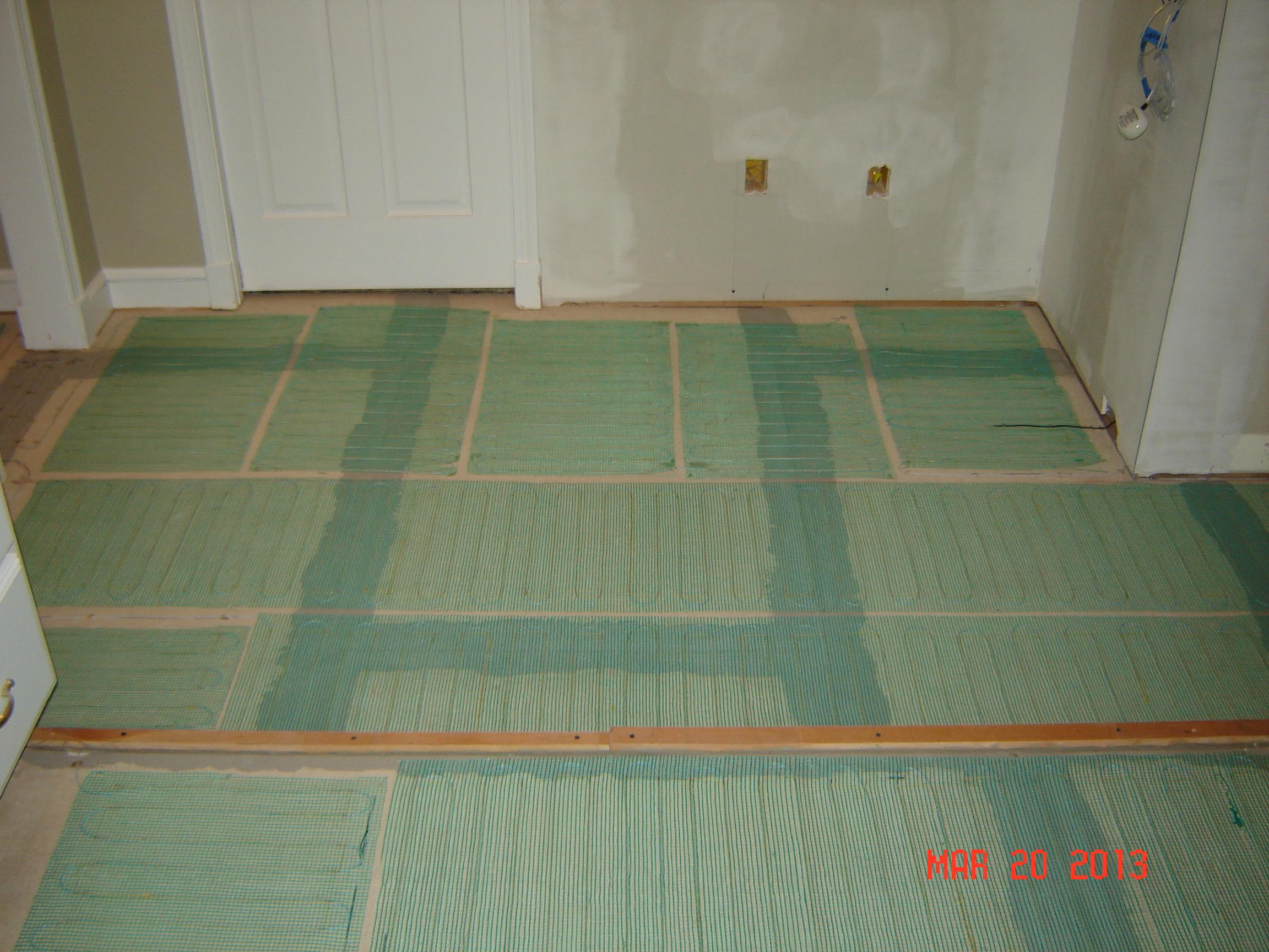 heated floor being installed