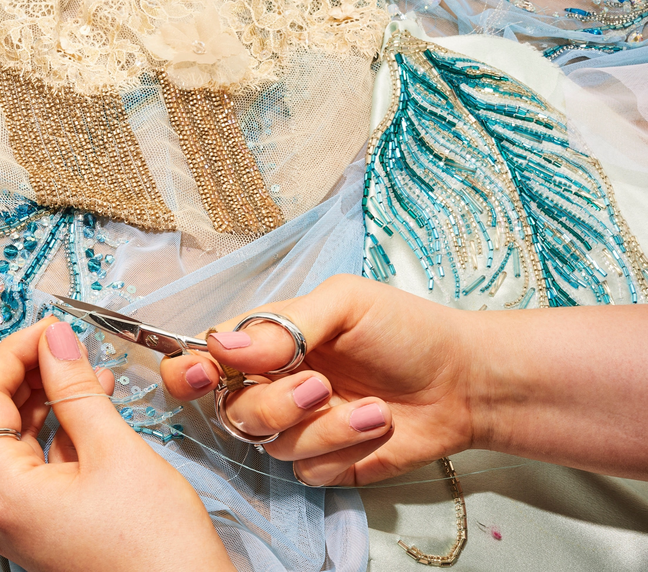 Hands with blue and white fabric