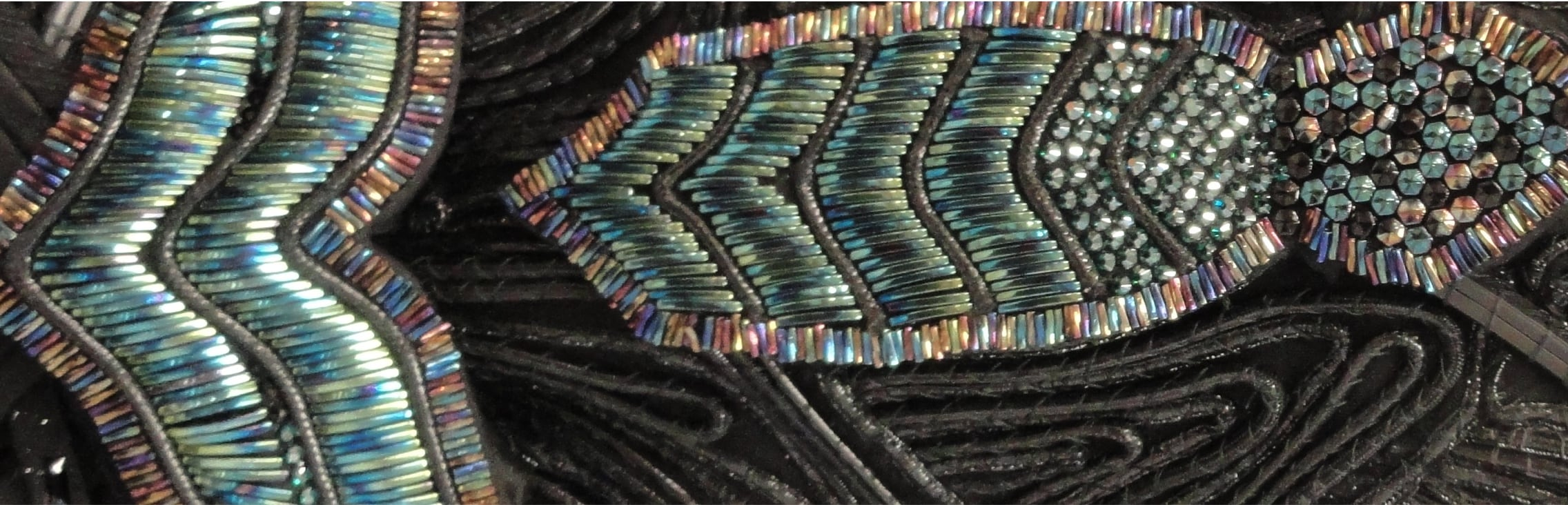 The Wiz Live header image black fabric with colorful beads