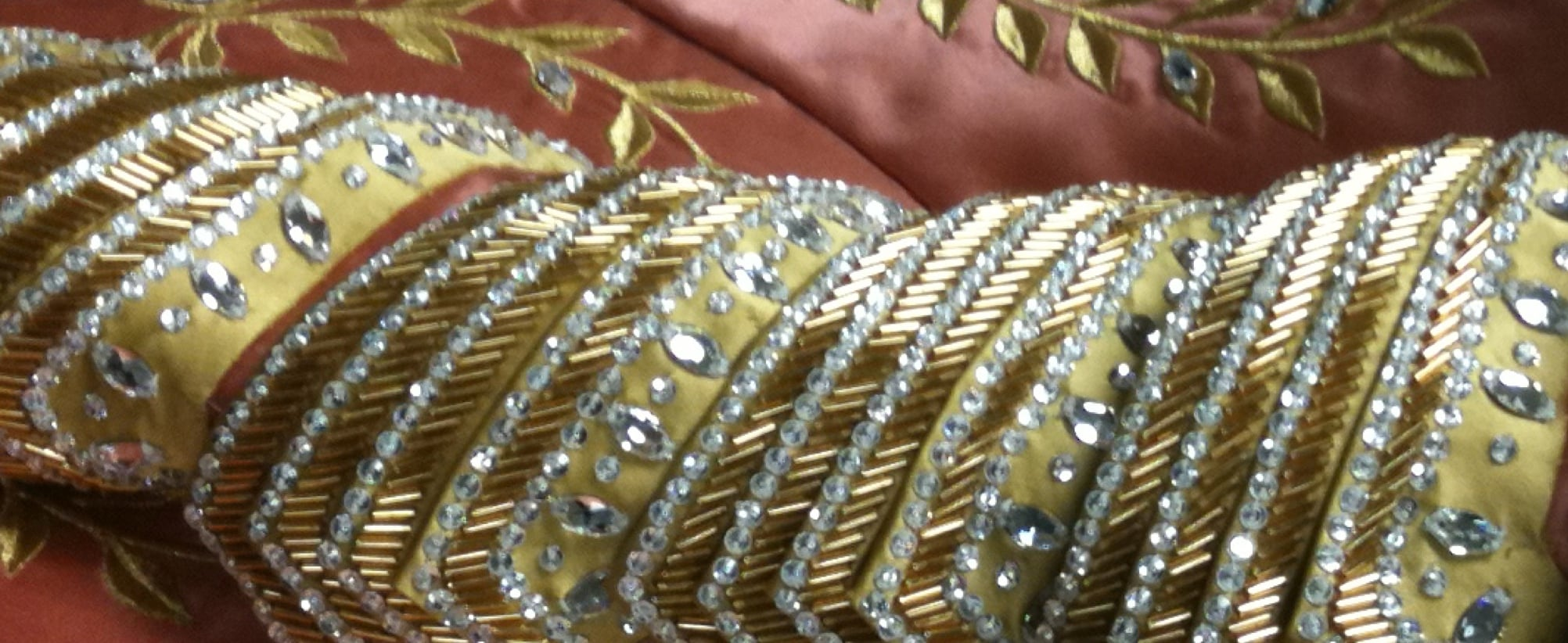 Mirror Mirror header image- gold fabric with sequins