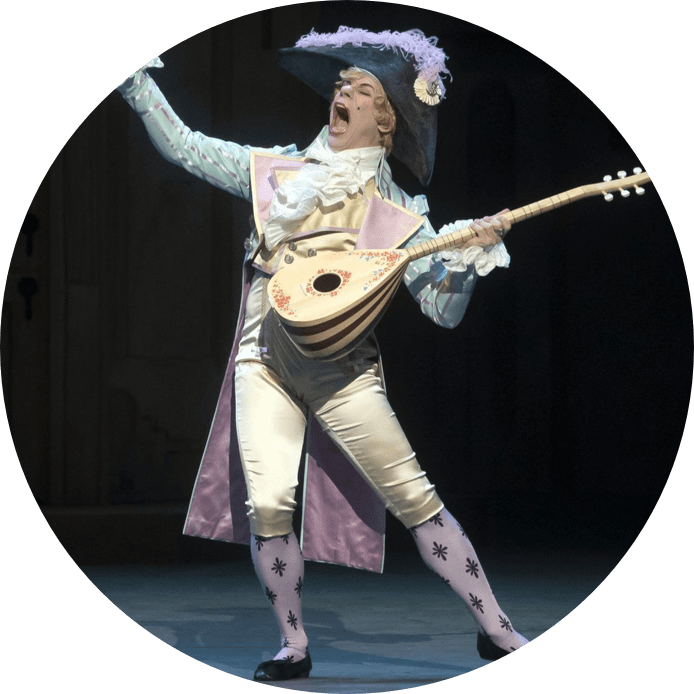 Harlequinade feature image: person with instrument singing on stage