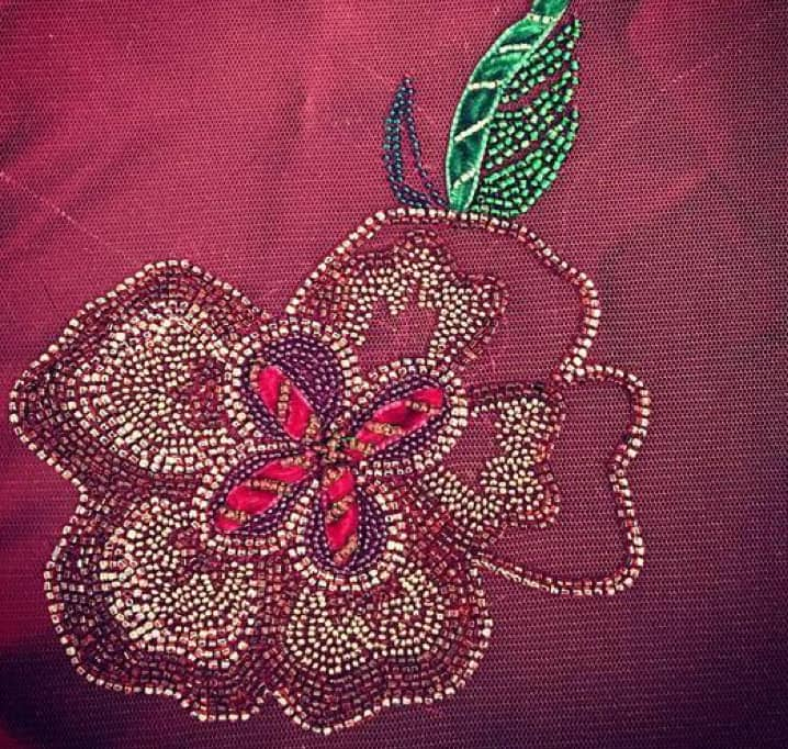 beadwork on red fabric
