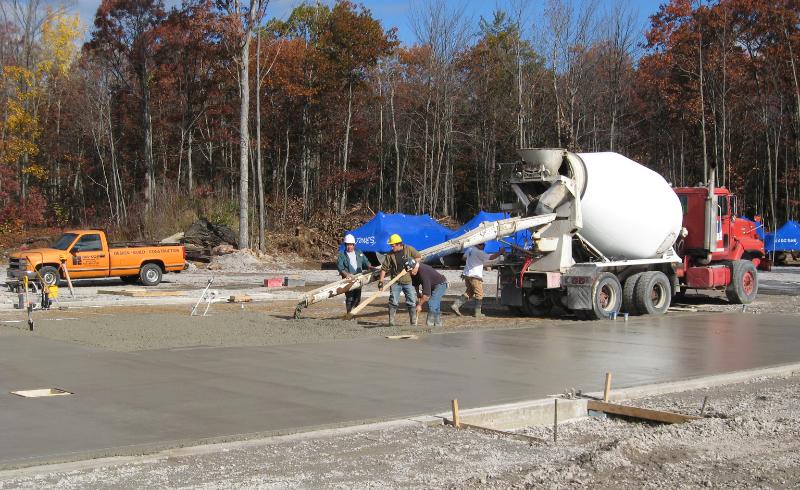 Truck delivering concrete on job site