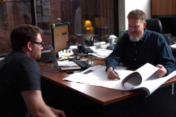 2 men reviewing building plans