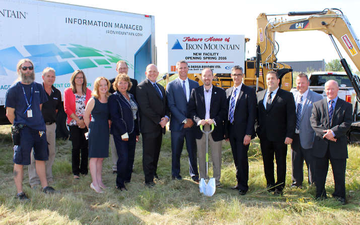 People posing at ground-breaking ceremony at Iron Mountain job site