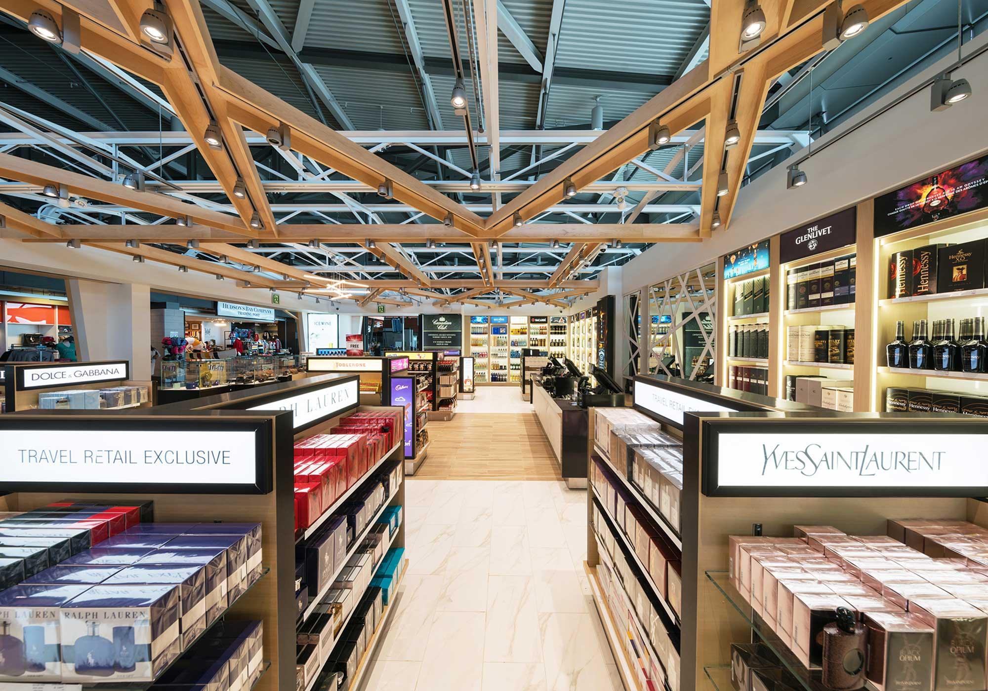 Aisles of merchandise under a lattice work ceiling