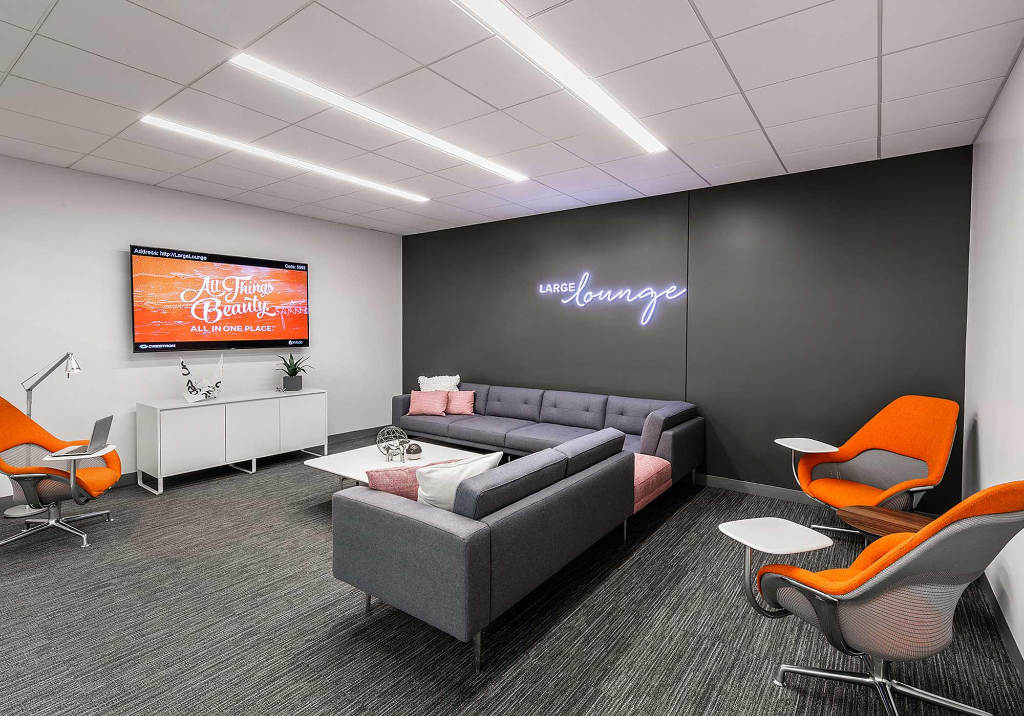 Lounge room with a large flat screen television