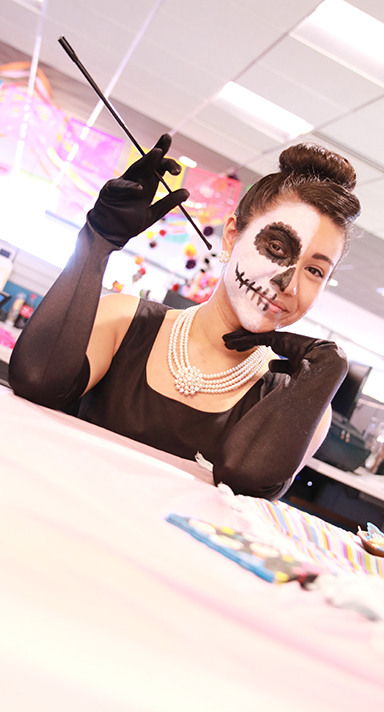 A woman in a Day of the Dead costume