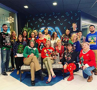 CDA team members wearing Christmas sweaters
