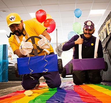 Two men pretending to be Mario characters racing