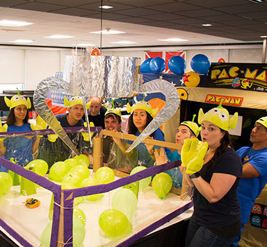 Team members dressed as aliens from Toy Story
