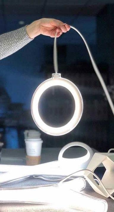 A person holding a circular light