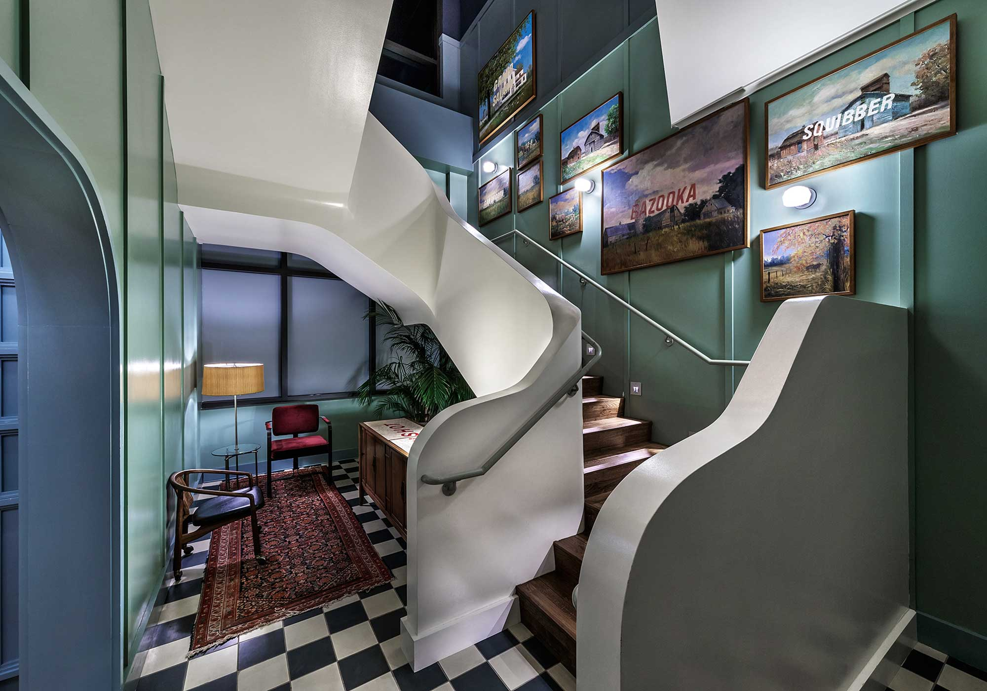 Staircase with art on the wall