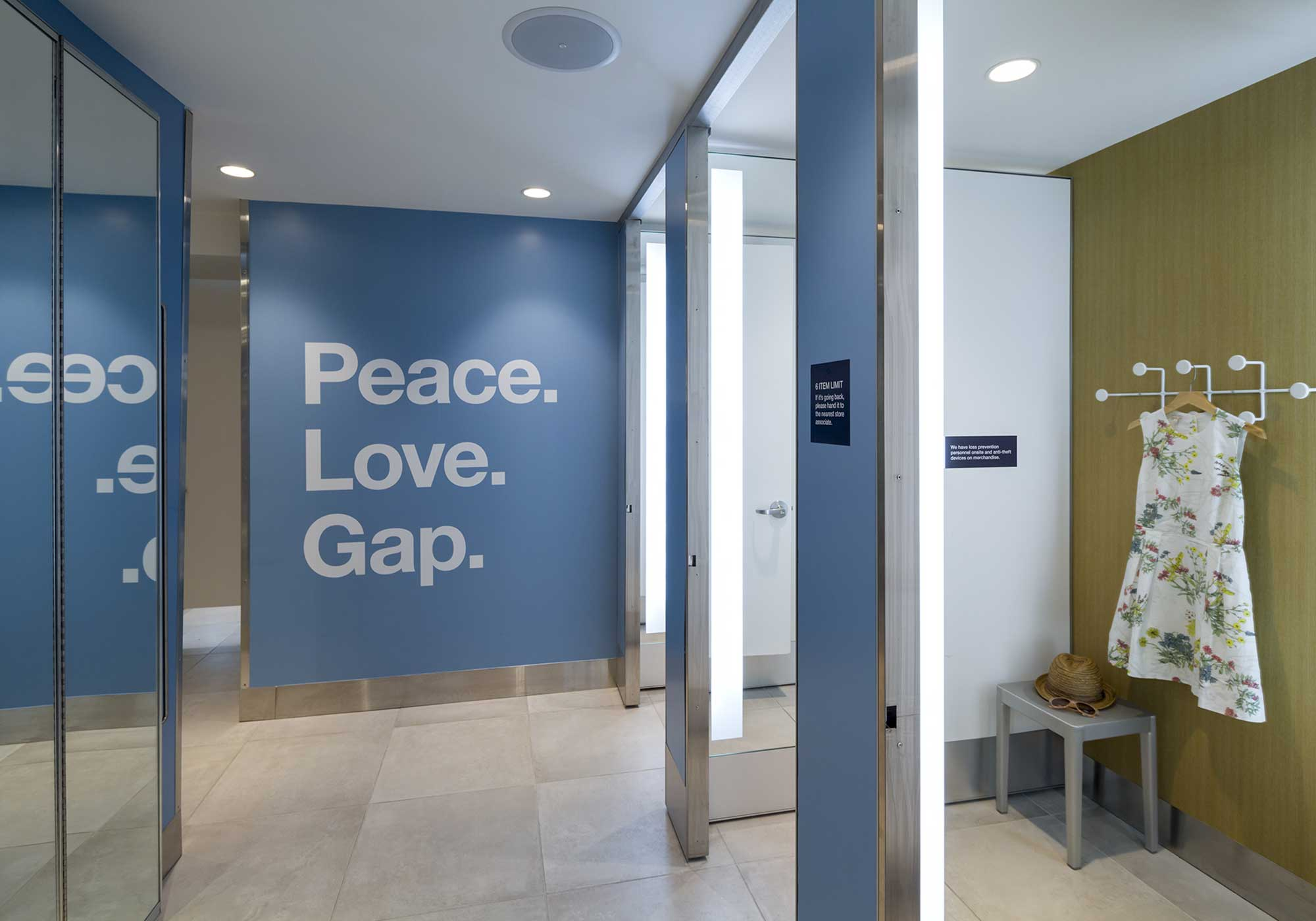 Fitting room area with Peace. Love. Gap. sign