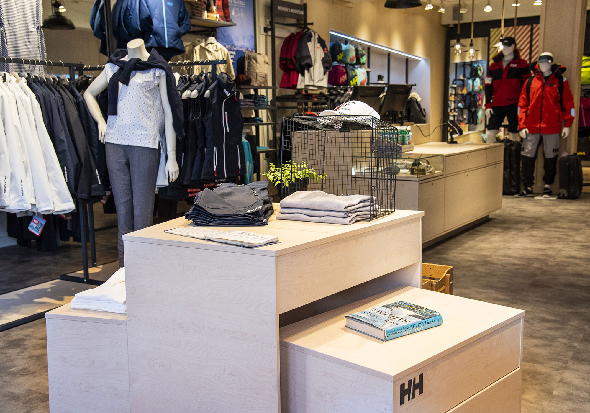 Display with a book on top with active wear in the background