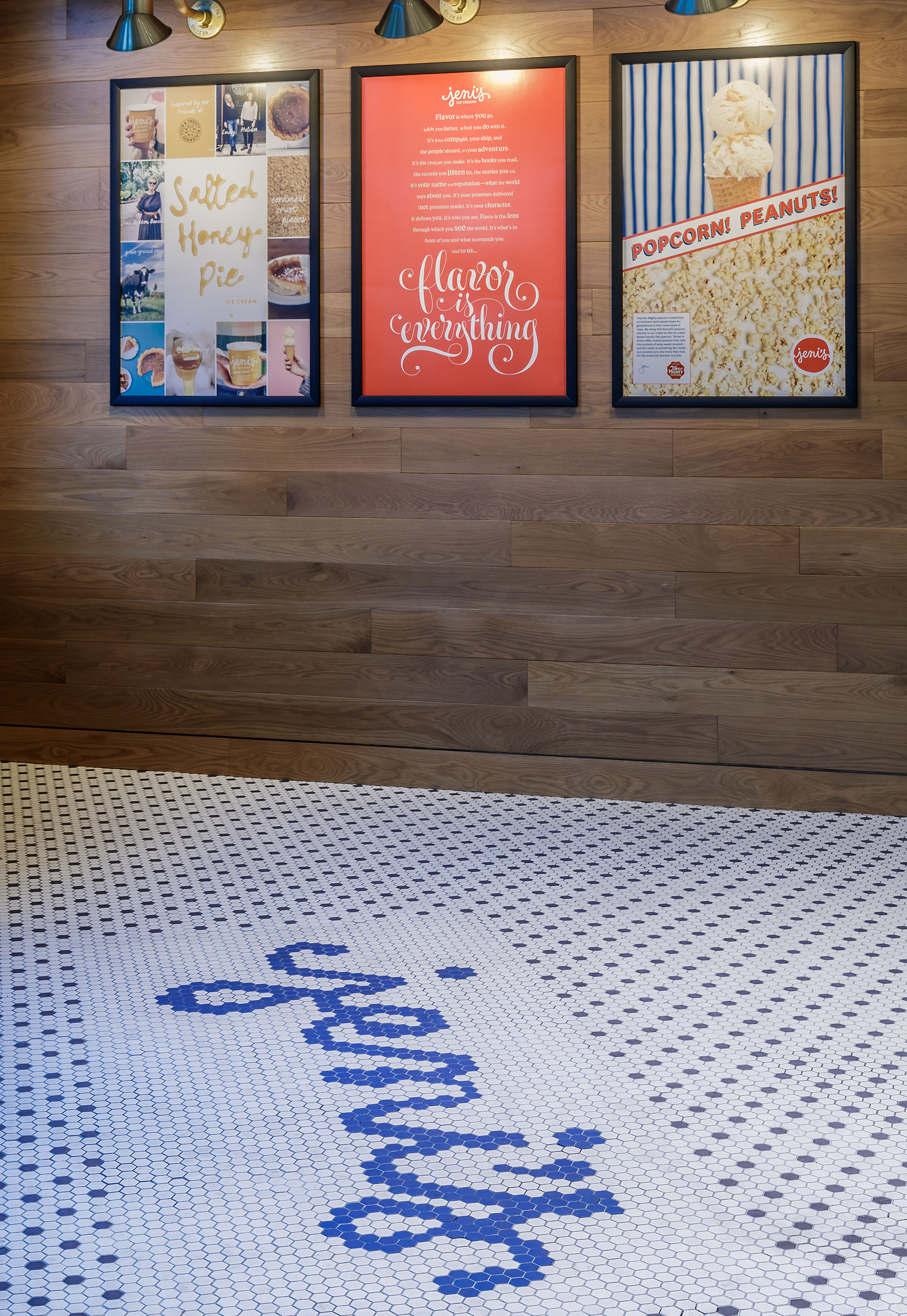 White tile floor with Jeni's in tile letters