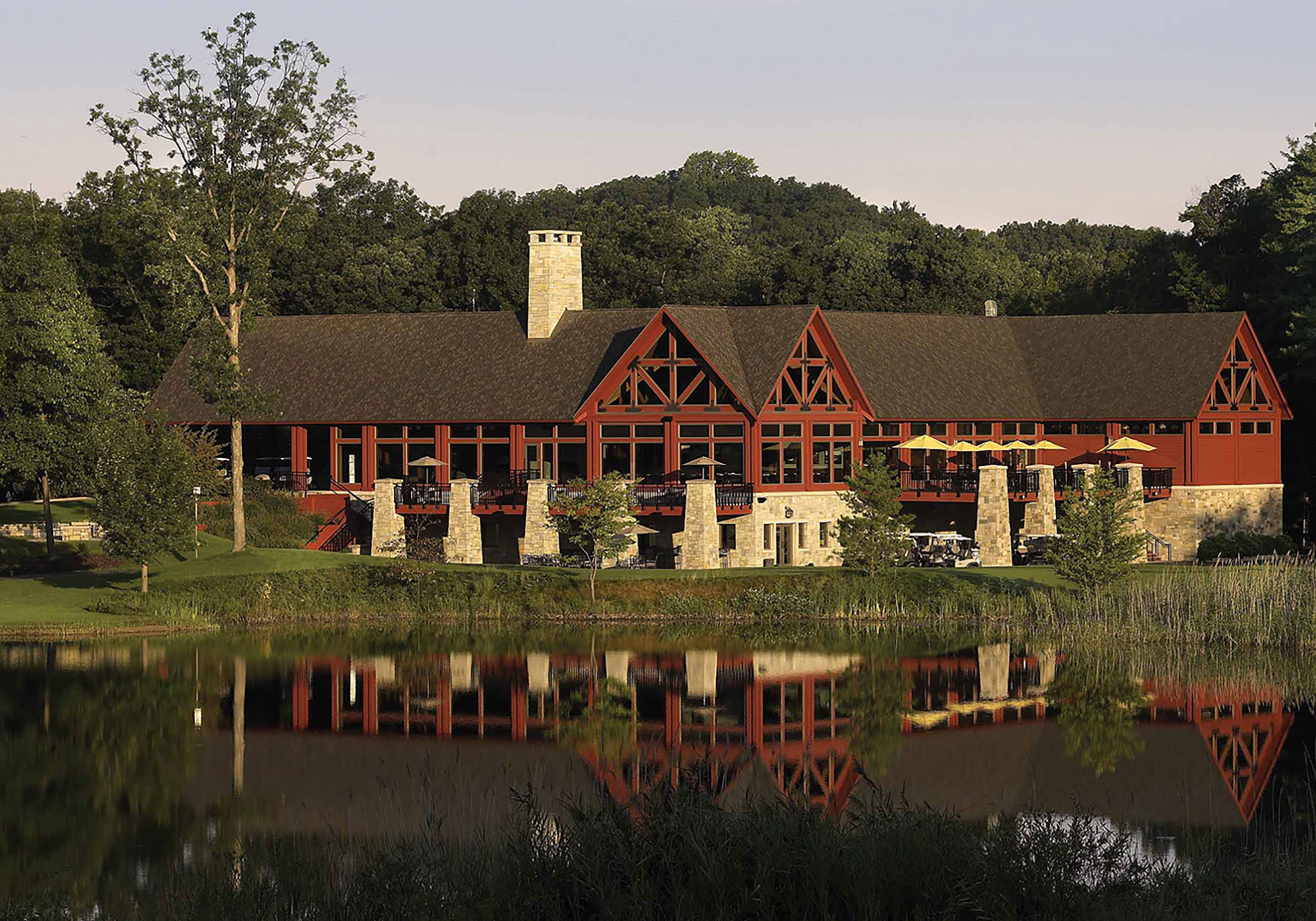 Exterior of the golf club with its reflection in a body of water