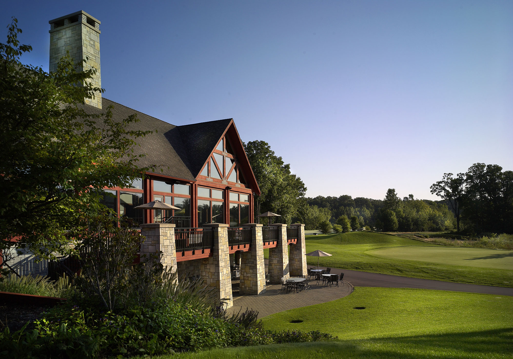 Exterior of the golf club and the surrounding lake
