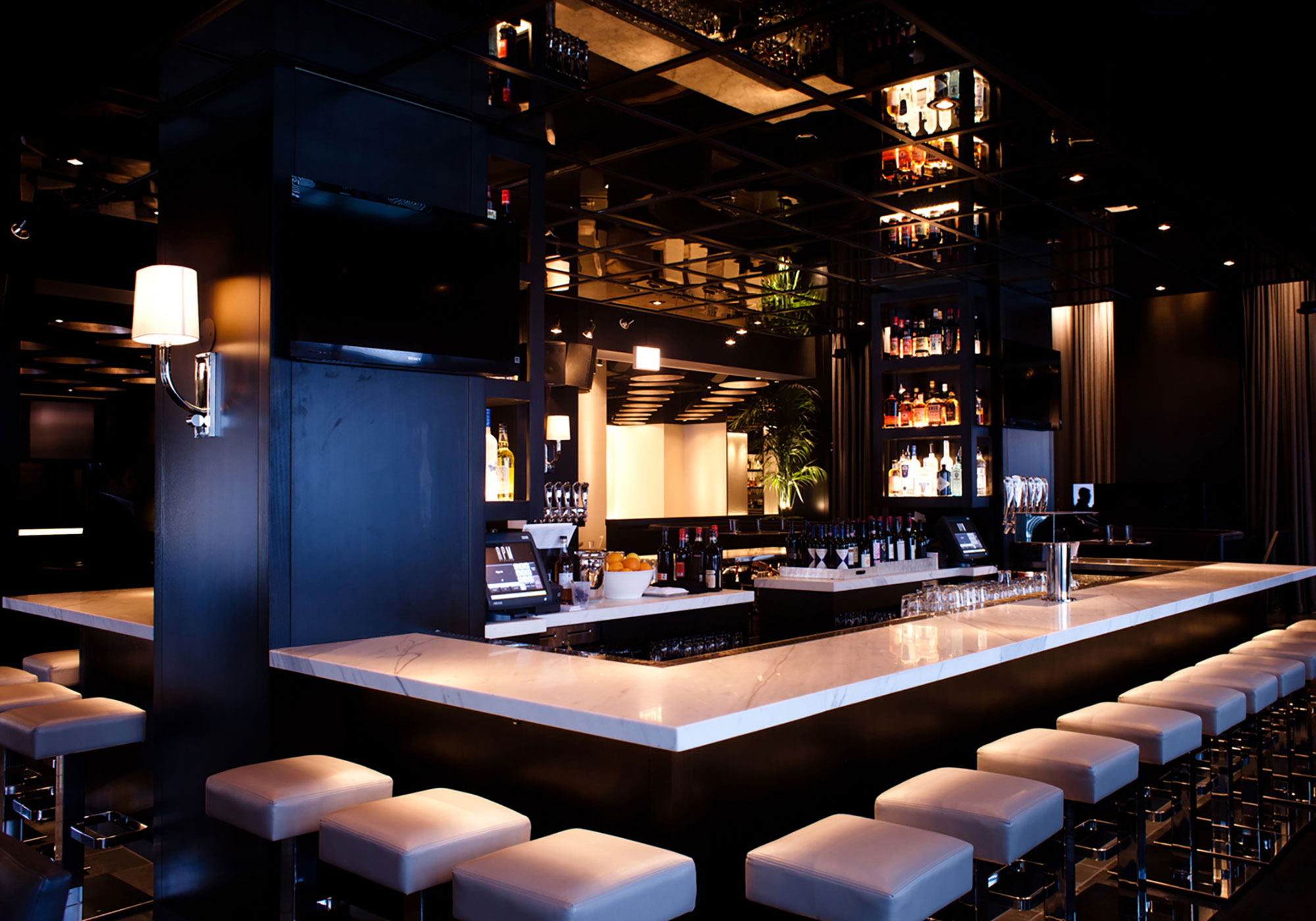 A square bar with square barstools