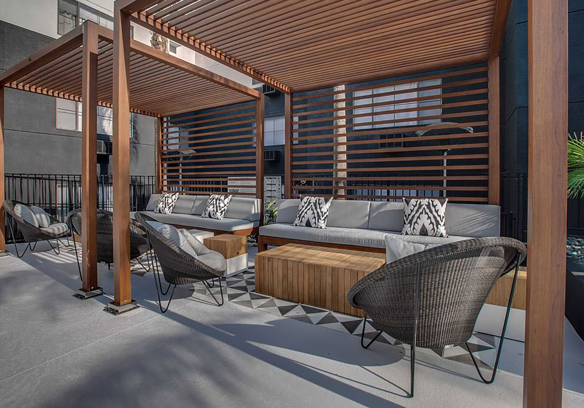 Outdoor seating under wooden slats