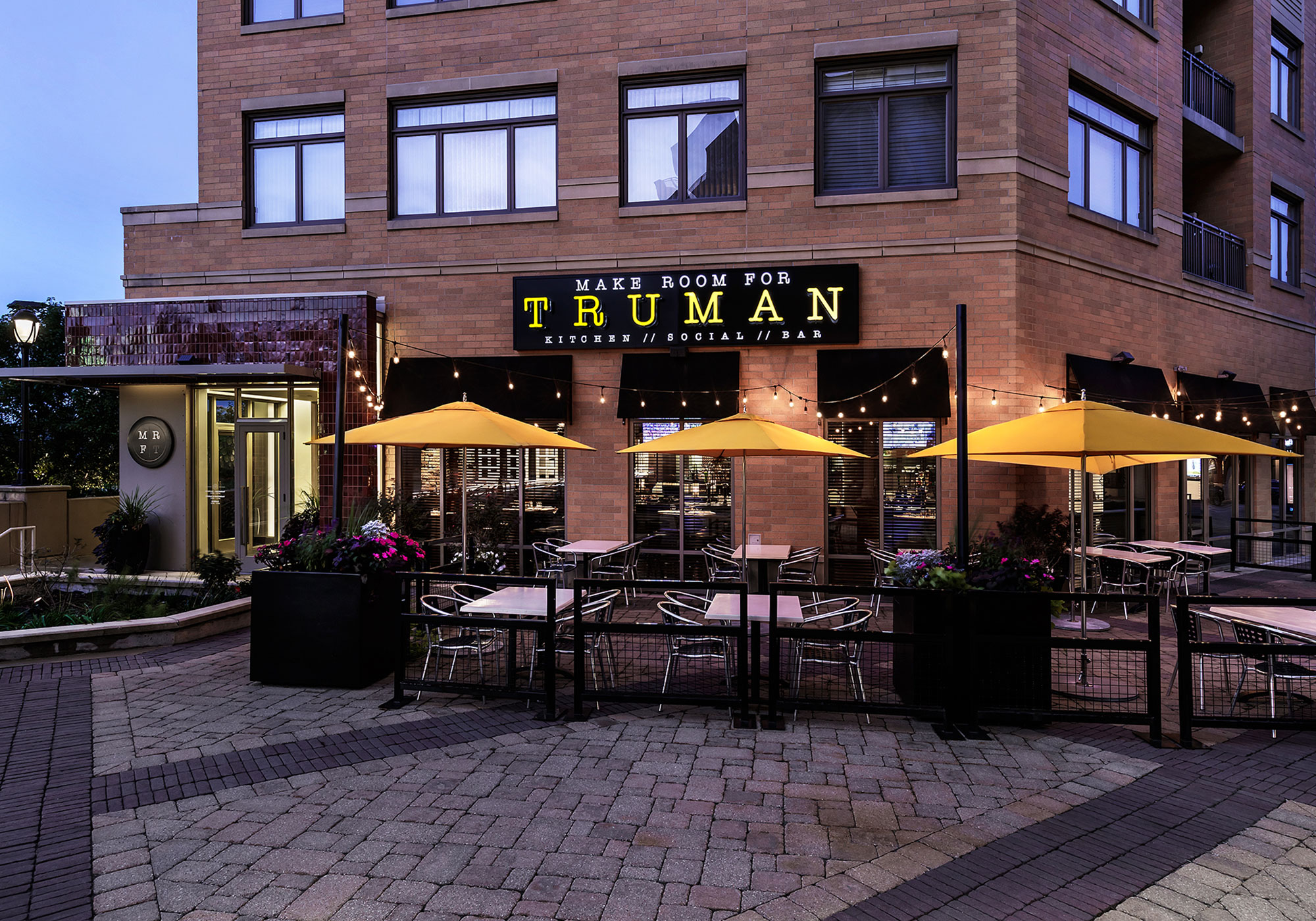 Make Room for Truman storefront in the twilight hour