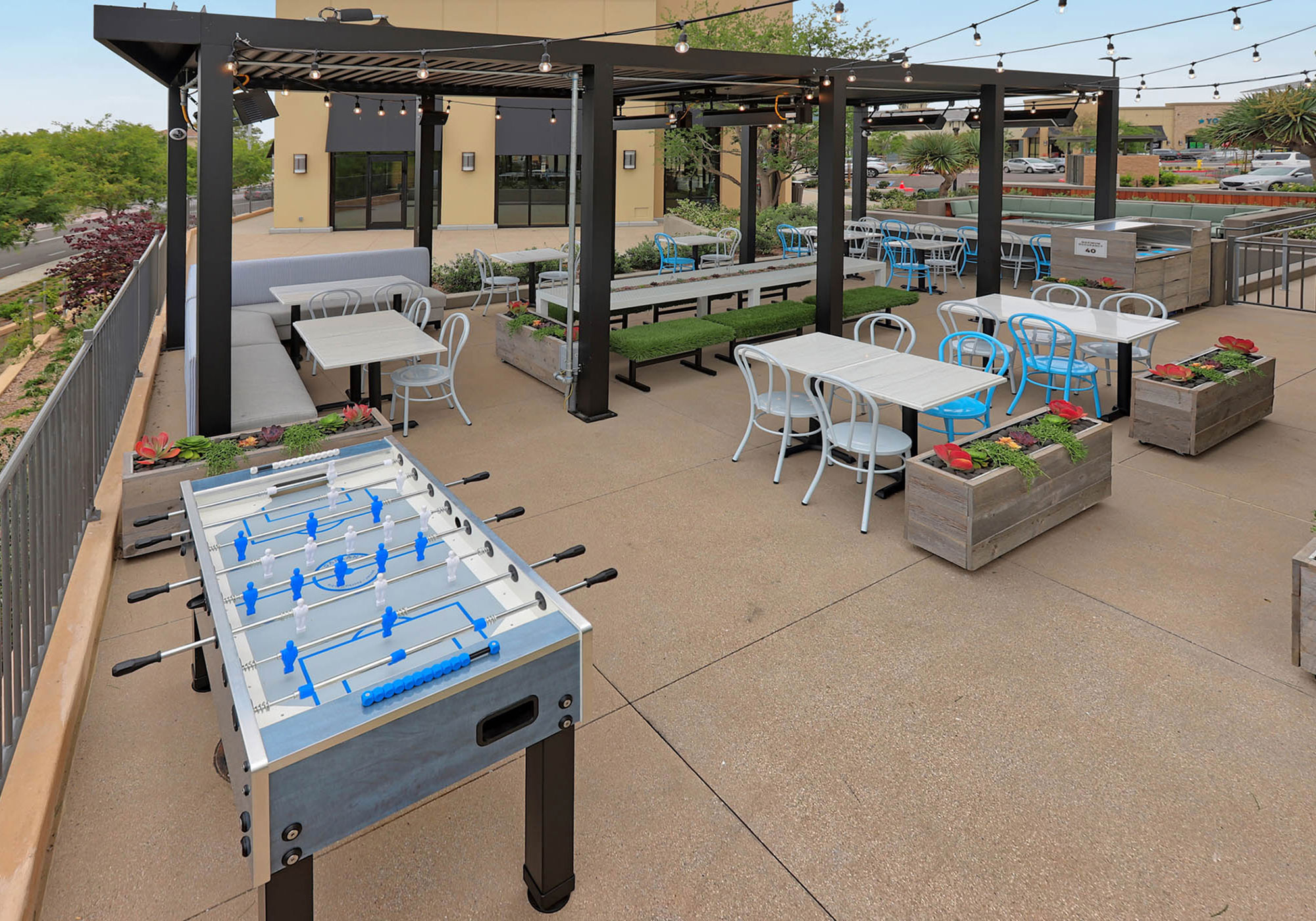 Outdoor patio with a foosball table