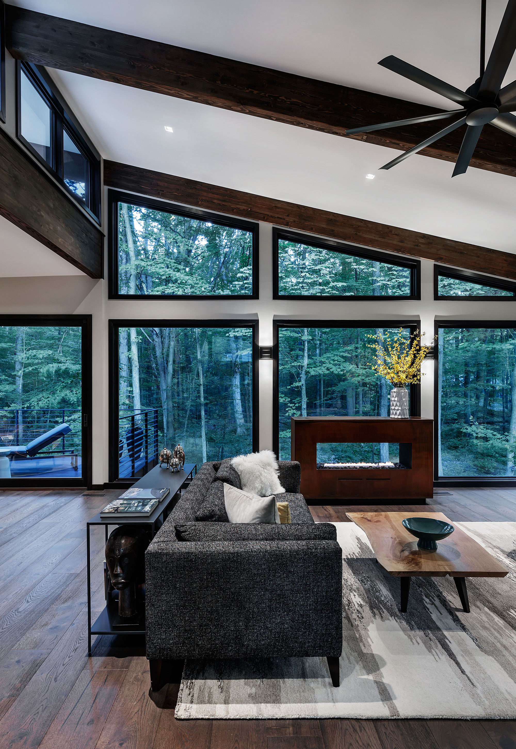 Living room with sofa and a view into a forest