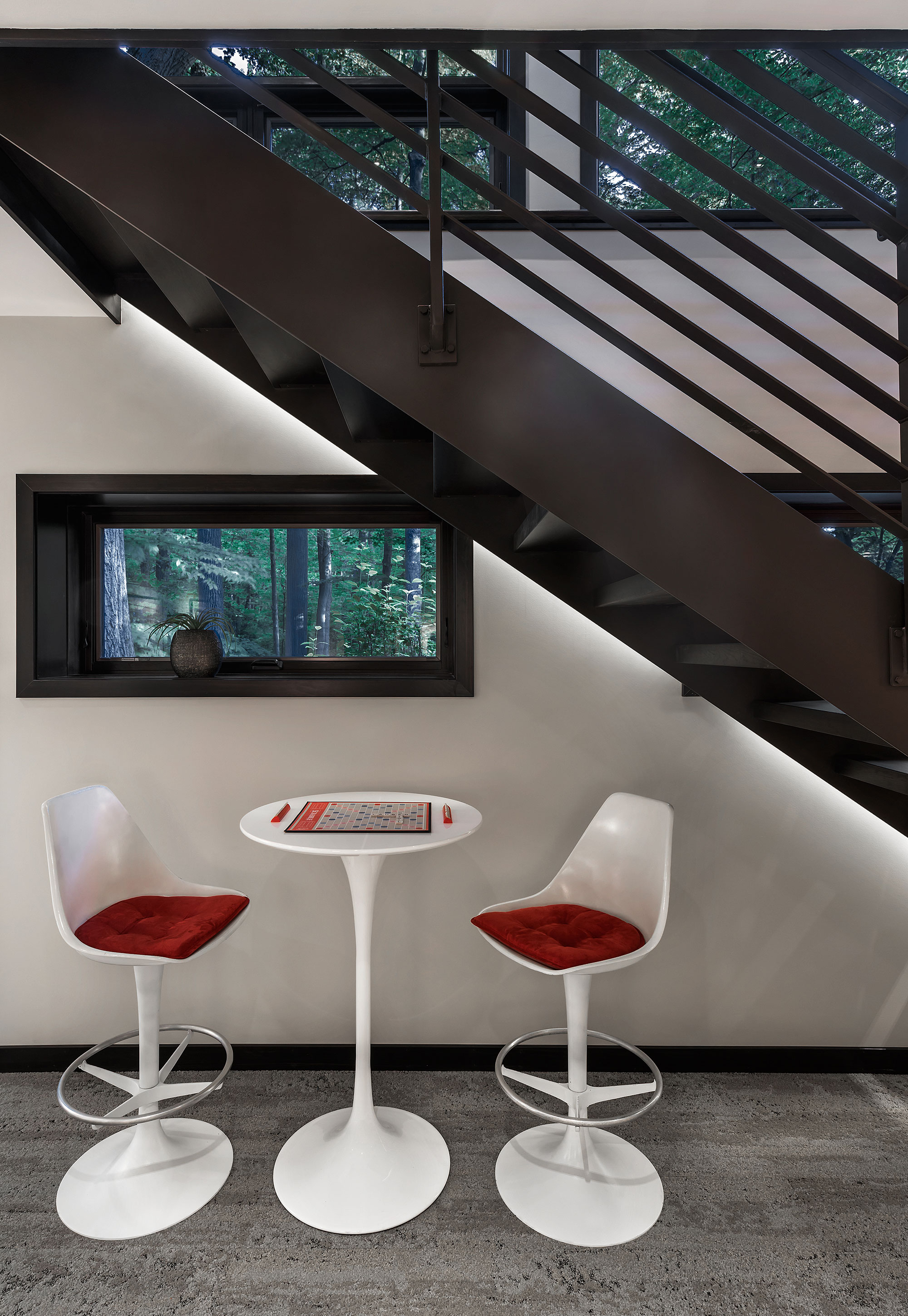 Table and chair set under a staircase