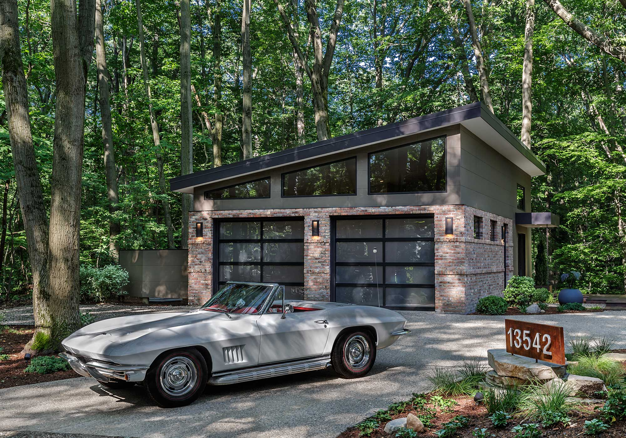 Classic car in front of a garage