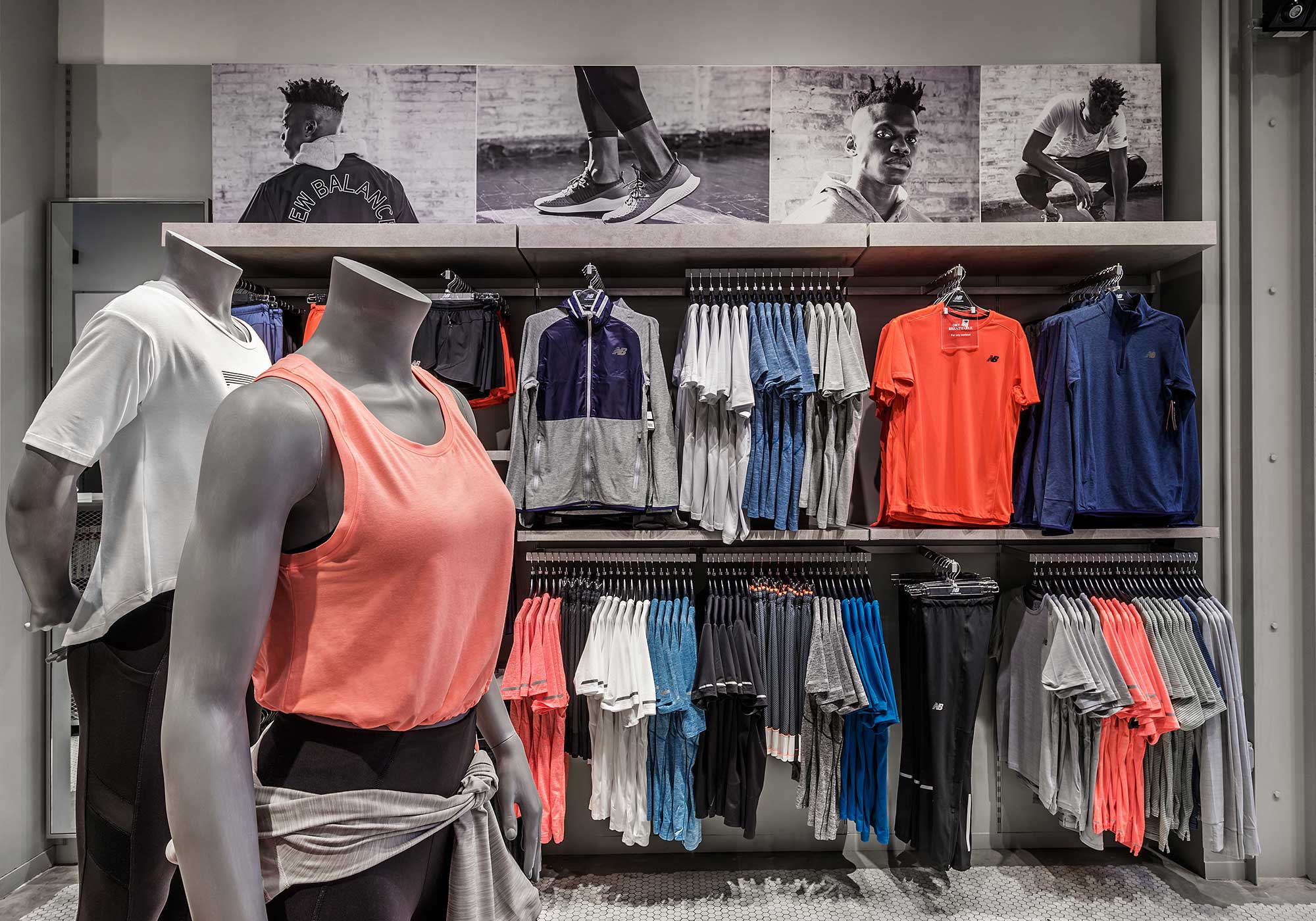 Mannequins in sportswear in front of a clothing display