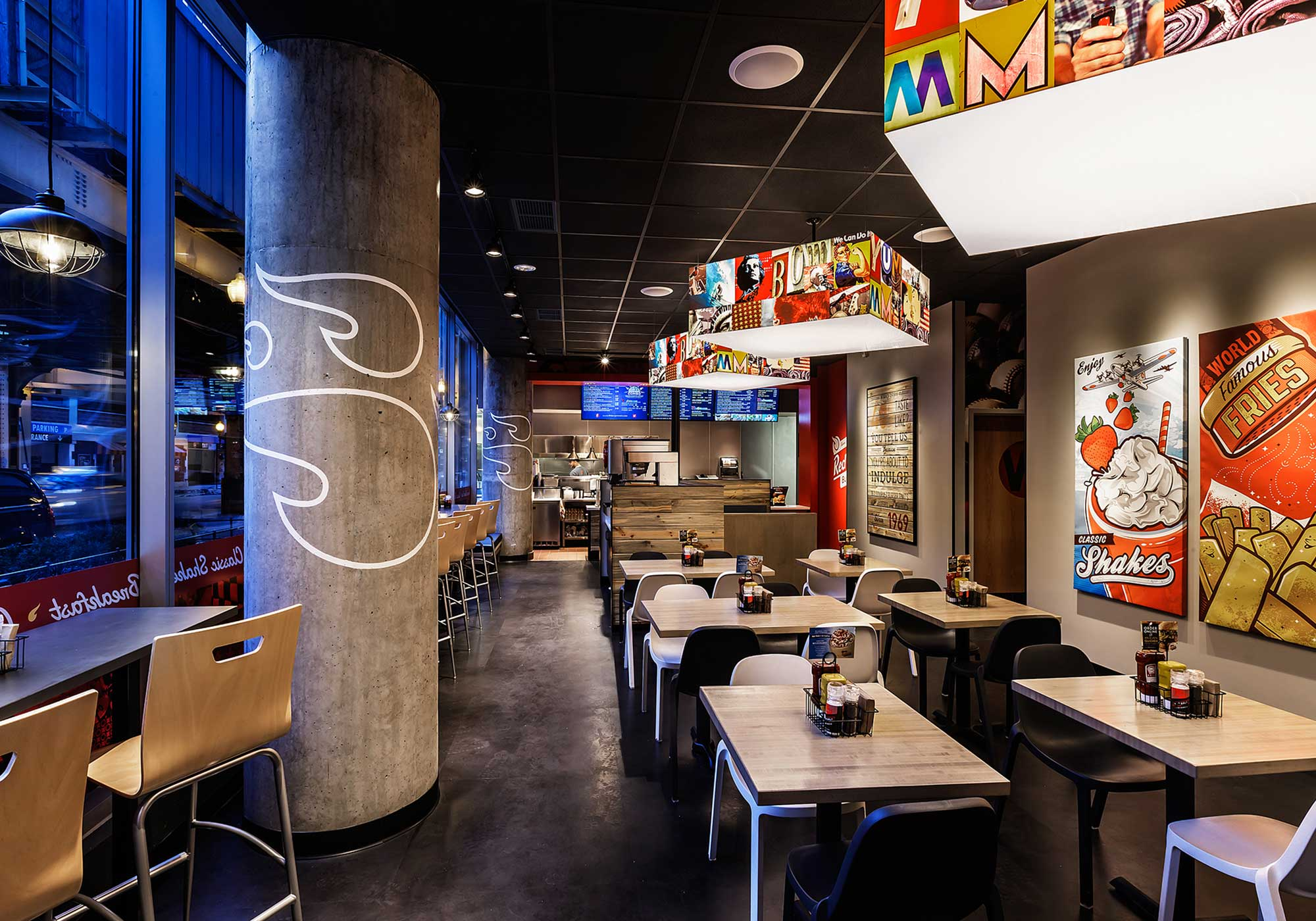 Dining room with art on the walls and light fixtures with pop art covers