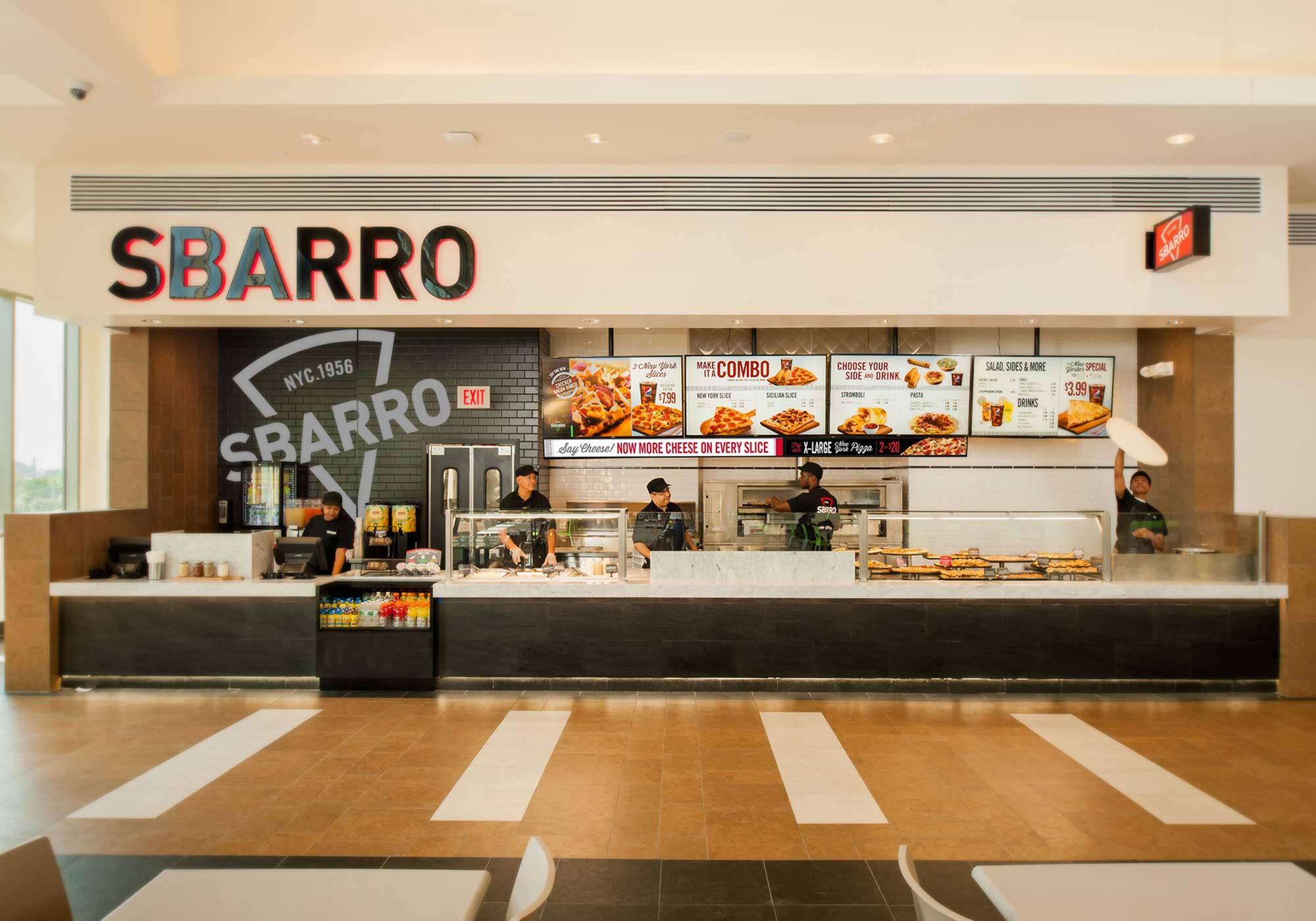 Sbarro storefront with an employee spinning pizza dough