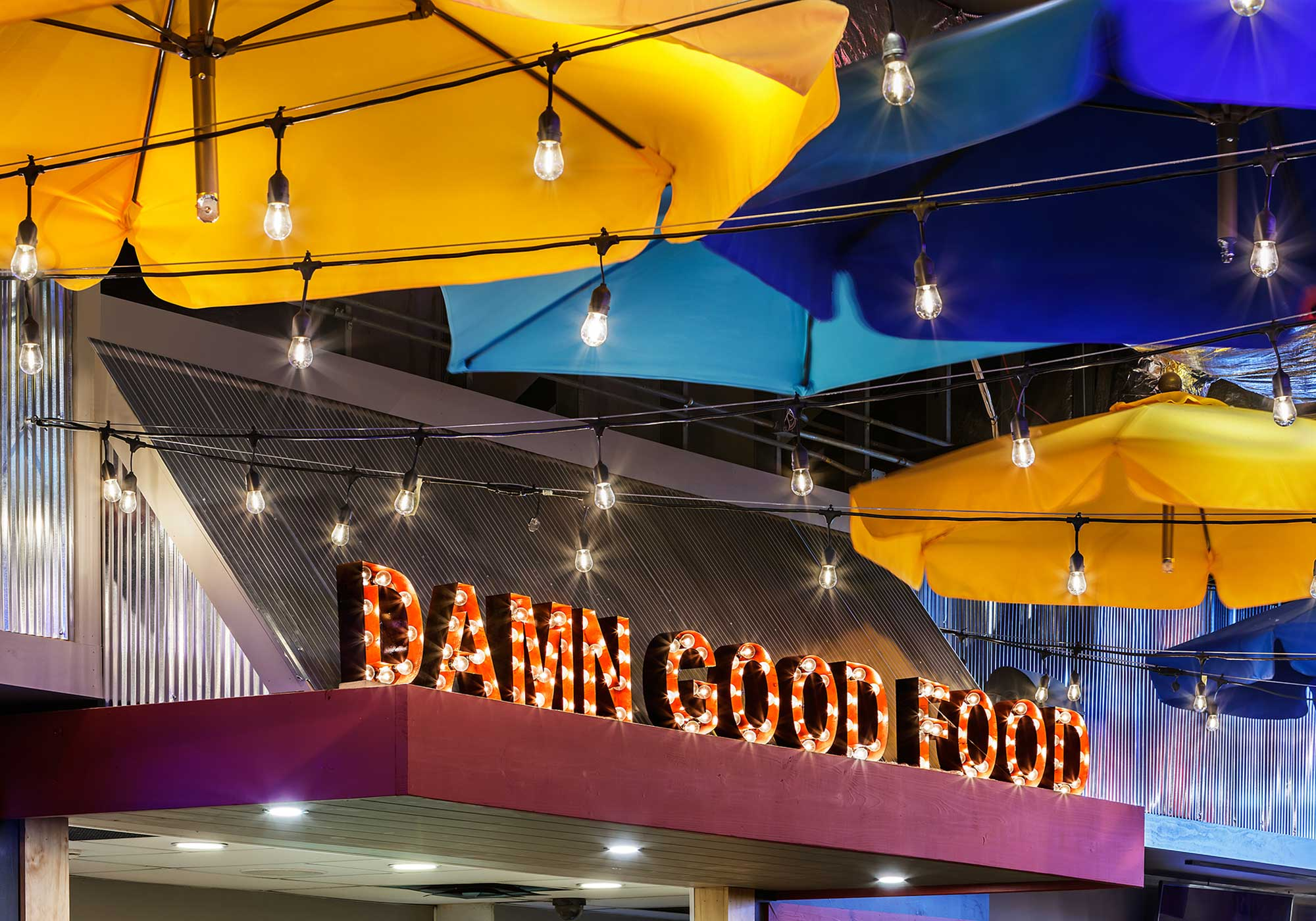 """Lighted sign with text that says """"damn good food"""""""