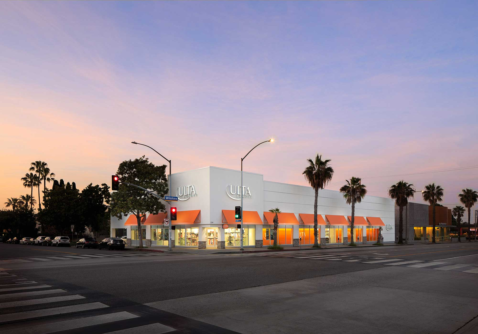 Los Angeles storefront with palm trees lining its perimeter