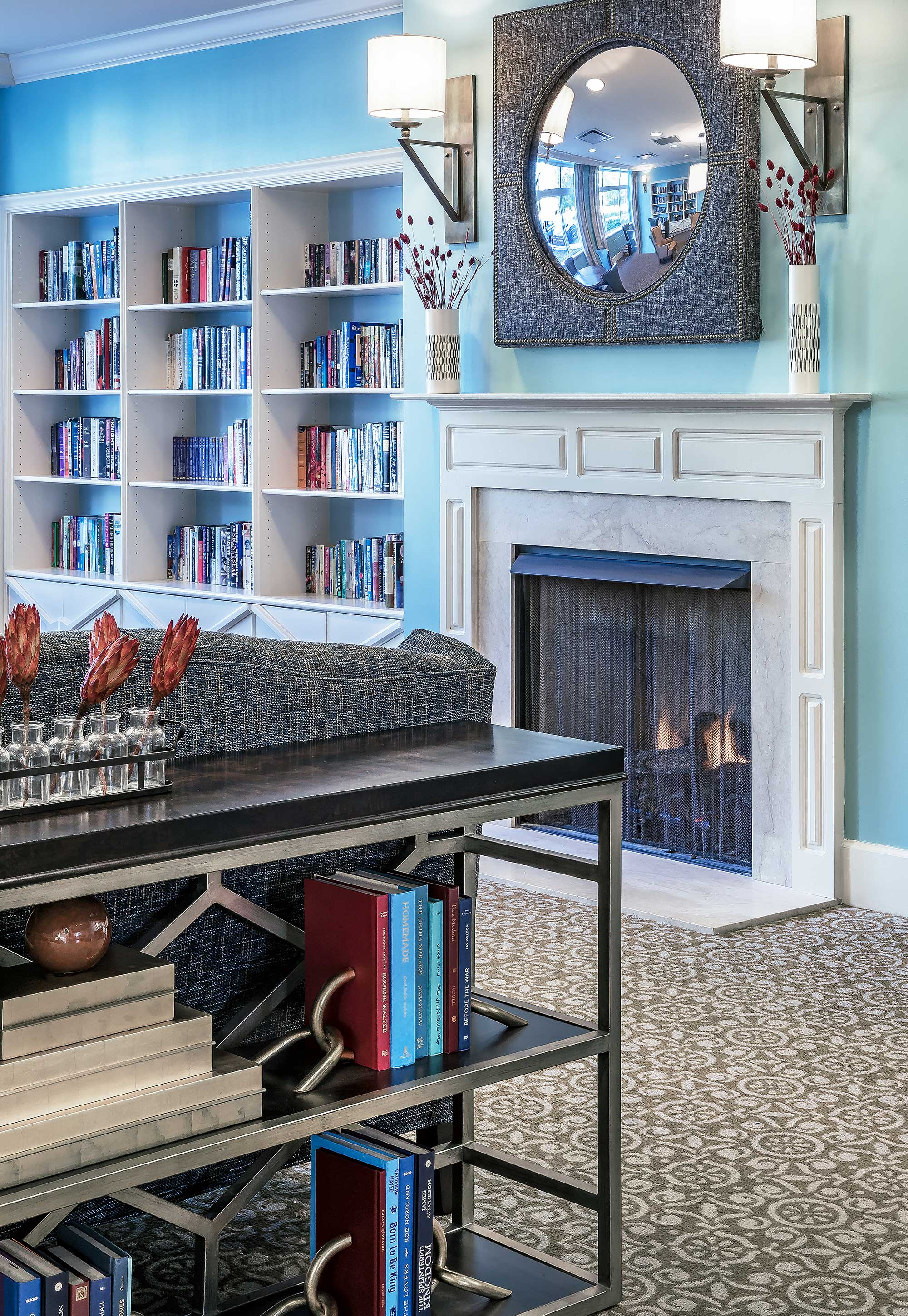 Common area with fireplace and shelves filled with books